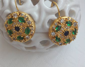 Antique earrings with green emeralds and white sapphires