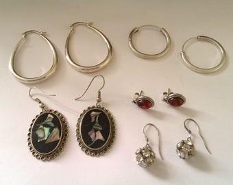 five pairs of earrings