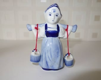 Dutch milk maid with buckets blue and white