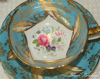 Paragon, England: Double warrant blue tea cup & saucer with fresh flowers