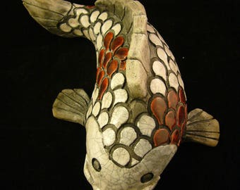Red and white koi carp raku firing technique