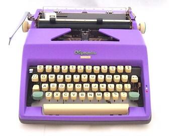 Olympia Monica typewriter, purple typewriter, working typewriter, vintage typewriter, portable typewriter, qwerty.