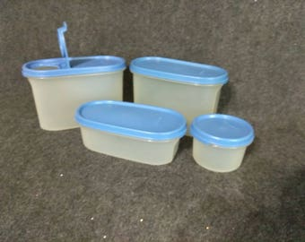 Tupperware 4 Pieces with lids. PreOwned well cared for.  COME LOOK