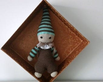 Crochet doll in cotton, with safety eyelets.