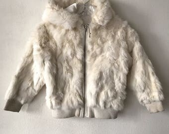 White rabbit fur coat woman size extra small .