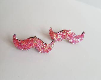 Sparkly moustache earrings made from wood and covered in glitter. Great for stocking filler or secret Santa gift. Bright pink sparkles