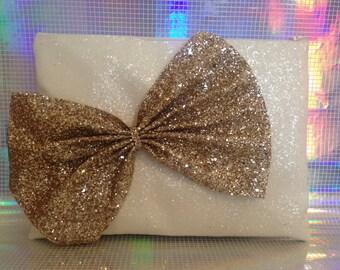 White and gold glitter clutch bag