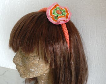 Headband hard orange salmon covered with crocheted bags with plastic recycled