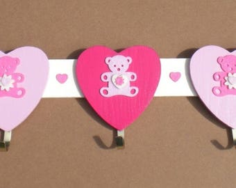 Racks in wood, hearts and pink bears