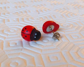 Studs with wooden ladybugs