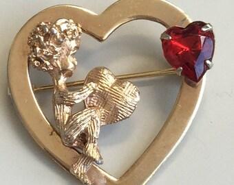 Adorable vintage cherub heart brooch .