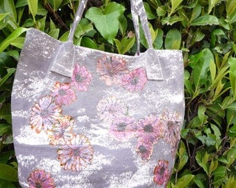 Bag painted purple with pink painted flowers