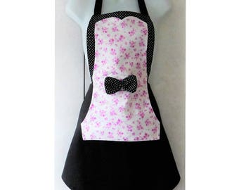 Romantic woman in pink and black apron