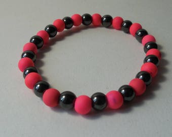 Bracelet 6 mm hematite and neon pink beads.