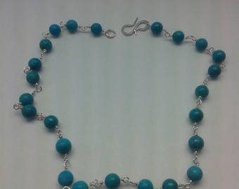 Turquoise sterling silver rosary link necklace.