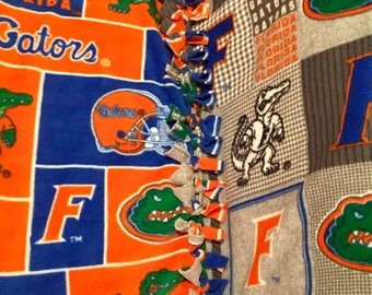 University of Florida Gators! handamde blanket designed by JAX. A College footbal football theme throw has liscensed Gators patterns fanfav