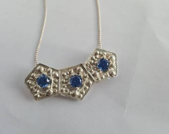 Beautiful necklace with pentagons. Choker. Necklace with 5mm blue zircons