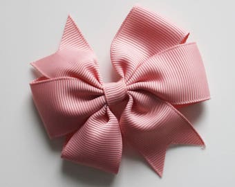 Old pink bowtie hair clip