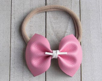 Barbie pink faux leather bow with suede center