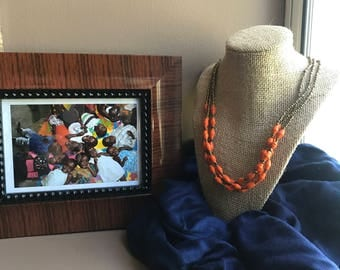 Orange multi stranded necklace