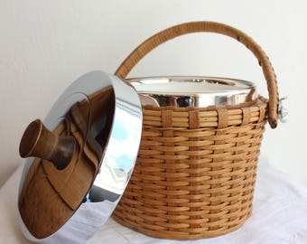 Vintage ice bucket with wicker exterior and handle, and chrome lid with teak knob