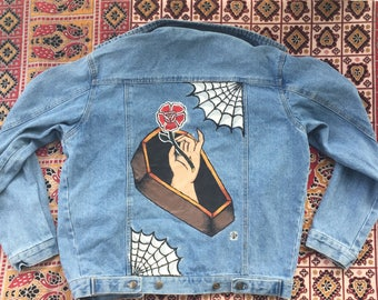 Hand painted jean jacket with coffin and flower