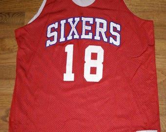 ... Vintage NBA Champion Philadelphia Sixers (76ers) reversible basketball  practice jersey ... 278d828a3