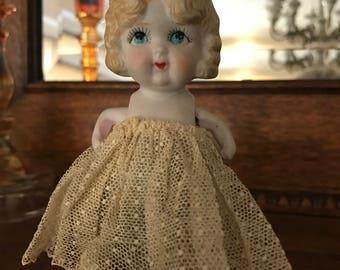 Antique frozen charlotte bisque doll Japan