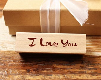 "Wooden and rubber stamp ""I love you"""