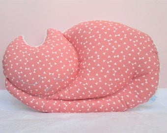 Cuddly cat sleeping in coral pink and white cotton and minkee fabric