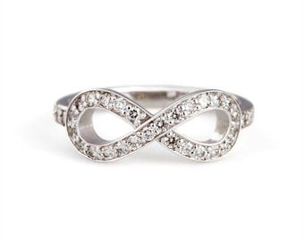 "14k white gold diamond ""infinity"" ring"