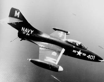 Grumman F9F-2 Panther of VF-24 over Task Force 77 in July 1952