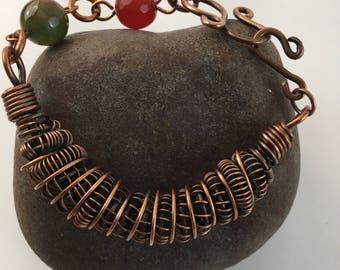 Copper coiled bracelet. Faceted Jade.