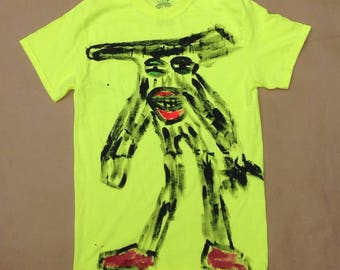 A day glow yellow T shirt with a handprinted image of my slender man on the front