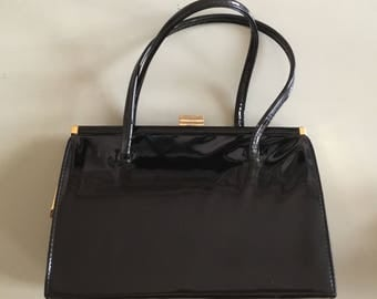Black patent leather kelly bag made in Ireland