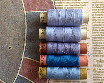 Spools of threads set. Vintage organic cotton 5 threads spools in blue-lilac colors.
