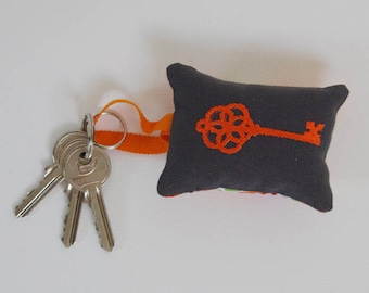 Orange embroidered keychain