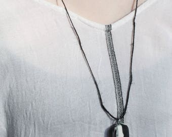 Black cord necklace with marbled pendant