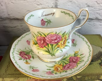 January Carnation Queen's Rosina Tea Cup and Saucer Flowers of the Month Fine Bone China Vintage England Made Lovely EVC Pink Yellow