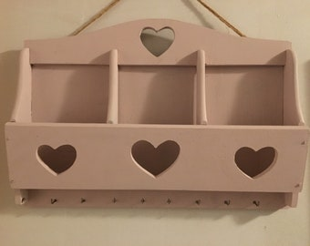 Hanging letter And Key shelf With Heart Cutouts painted in pink.