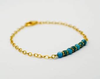 gold-plated bracelet with turquoise