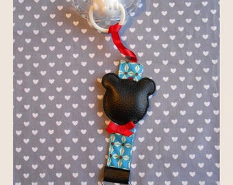 hanging red blue pacifier