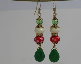 Dangle earrings in red, green, gold and white. Jadite drop and red polka dot bead