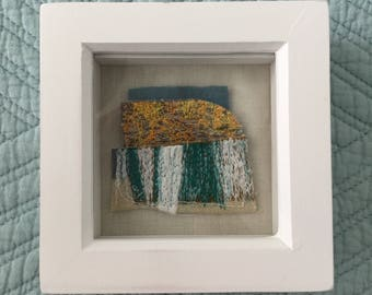 Land. Embroidered landscape artwork on wool and linen.