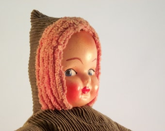 Vintage celluloid mask face doll with stuffed corduroy body