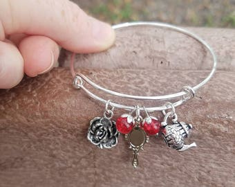 Beauty and the Beast expandable bangle with rose, mirror, and teapot charms.