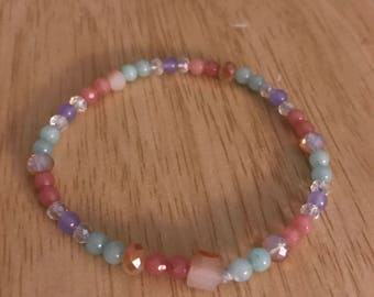 Cyan, pink & purple jade- helps with balance , wisdom and peace