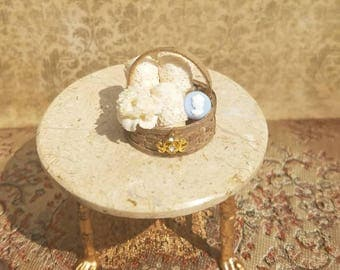 Miniature dollhouse basket of towels and soap, 1:12 scale.