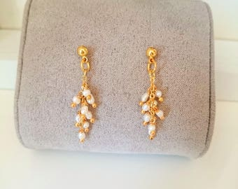 Tiny pearl earrings