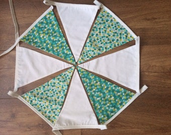 Green and white bunting with flowers